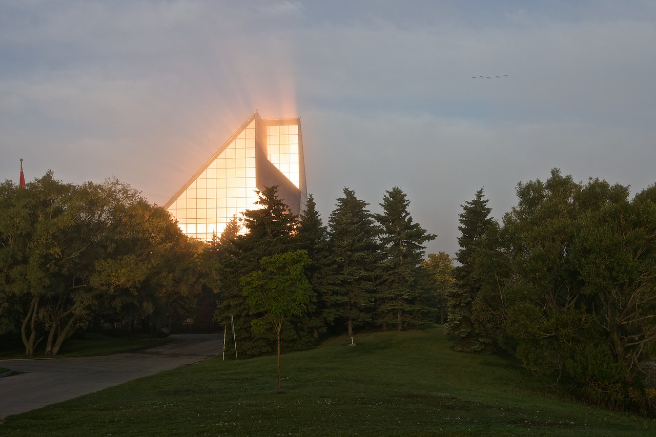Royal Canadian Mint with sun reflecting through the mist