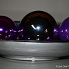 ORNAMENTAL ELEGANCE - 3<br /> <br /> Keeping with the theme colors of the December (Christmas) table setting, I added two purple ornaments to this home accent. The silver orb in the middle is one of three orbs that came with this Long Silver Ceramic Tray.<br /> <br /> (photo taken 11/23/2012)
