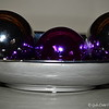 ORNAMENTAL ELEGANCE - 4<br /> <br /> Keeping with the theme colors of the December (Christmas) table setting, I added one purple ornament to this home accent. The two silver orbs on each end are two of three that came with this Long Silver Ceramic Tray.<br /> <br /> (photo taken 11/23/2012)