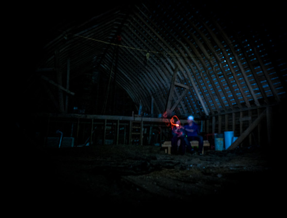 Playing inside the barn
