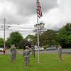 The Color Guard salutes the flag.