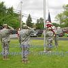 The Color Guard raises the flag.