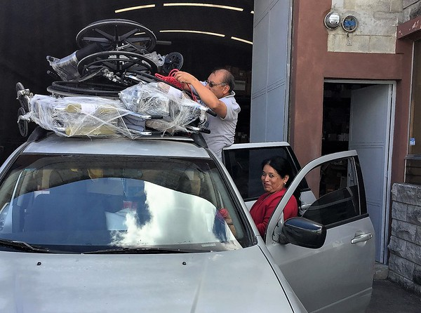 If you have seen me speak in the USA the last three or four years, this is the couple that makes the vests I wear.  The back is full, the wheelchairs tied tightly on top.  Iliana ALWAYS looks like she is going to get in trouble with the teacher!  She does a lot of work with expectant mothers and children.