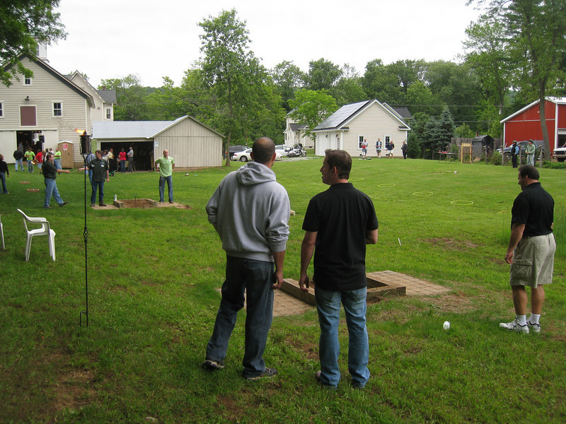 Corporate downtime includes a game of horseshoes.