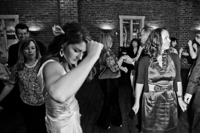 Nicolette and Logan celebrate on their wedding day at Californos in Kansas City on Friday October 7th 2011.