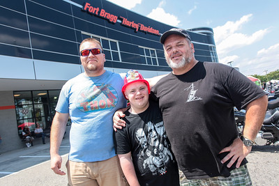 Chandler Rivera,  Early Bird Horan, and Earl Horan enjoy the day as Cape Beard: Follicles of Freedom holds their 6th annual Pig Pickin' benefiting the Autism Society of Cumberland County at Fort Bragg Harley Davidson on Saturday, May 27, 2017. [Raul F. Rubiera/The Fayetteville Observer]