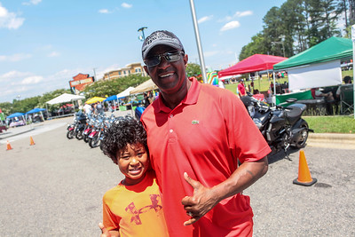 Dexter II and Dexter Barry Sr. enjoy the day as Cape Beard: Follicles of Freedom holds their 6th annual Pig Pickin' benefiting the Autism Society of Cumberland County at Fort Bragg Harley Davidson on Saturday, May 27, 2017. [Raul F. Rubiera/The Fayetteville Observer]