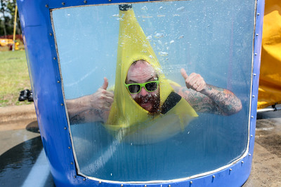 "Cape Beard: Follicles of Freedom President, Johnny ""Awesome"" Ivey takes a turn in the dunk tank wearing his favorite banana outfit as the beard and mustache club holds their 6th annual Pig Pickin' benefiting the Autism Society of Cumberland County at Fort Bragg Harley Davidson on Saturday, May 27, 2017. [Raul F. Rubiera/The Fayetteville Observer]"