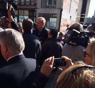 News cameras and smartphone cameras captured Rauner's arrival.