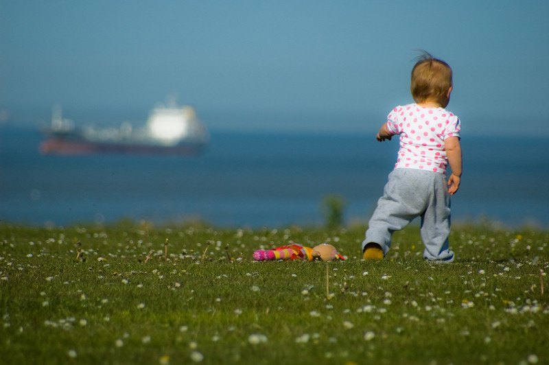 "Laura Watson  Palm Bay, England  ""Thank you both so much for the lovely photographs of my little Lola. They are brilliant!  I love how you were able to capture her character so well in just a couple of shots.  The scenery looks great with the bright, blue sea behind her, especially the one with the ship in the far distance.  They are all absolutely adorable, making me smile each and every time I look at them. I can't wait for more pictures in the future.  I can't thank you enough."""