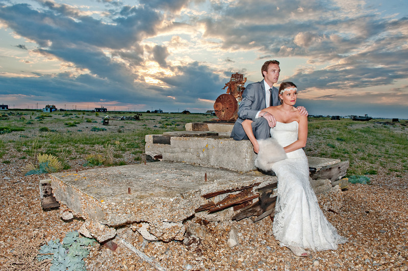 """Rich & Ika Hall Broadstairs, England  """"You're so clearly passionate about what you do and this translates into your pictures. Style, class and true beauty – every time I look through our wedding gallery I'm lost for words – which as you know is rare for me – at how talented you are. You worked really hard, capturing pictures others would have missed, and you made it so personal with unique touches that you just wouldn't find with anyone else. The reception party pictures were unbelievable - the portal party fisheye was an absolutely perfect touch! Not only was it great fun having our pictures taken with it, the photos were like nothing I have ever seen before, so cool and different, and I would recommend it to anyone. We were also lucky enough to go to Dungeness with you for the amazing Rock the Dress shoot. What a great evening and wow, weren't the pictures fabulous?! You're so much fun and we felt so at ease with you taking our pictures – even when sat in a digger! The hard work you put in to the post production was also phenomenal; not only with the actual photographs, but the slideshow and music you chose to accompany it, which made it very personal. I could go on and on, but you know how much we both love you. Thank you so, so much for everything you did for us. Love Ika and Rich Hall x"""""""