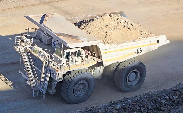 Mining dump truck hauling off a load (2018)
