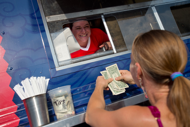 "Owner Natascha Hess takes a customers order in The Ginger Pig food truck at the new Rayback Collective food truck court in Boulder on Thursday. <br /> More photos:  <a href=""http://www.dailycamera.com"">http://www.dailycamera.com</a><br /> (Autumn Parry/Staff Photographer)<br /> July 28, 2016"