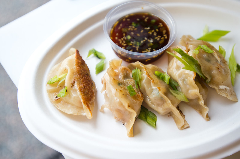 """Pork and ginger potstickers, made with local ground pork, seasonal vegetables and daikon is served with soy ginger dipping sauce by The Ginger Food Truck at Rayback Collective in Boulder on Thursday. <br /> More photos:  <a href=""""http://www.dailycamera.com"""">http://www.dailycamera.com</a><br /> (Autumn Parry/Staff Photographer)<br /> July 28, 2016"""