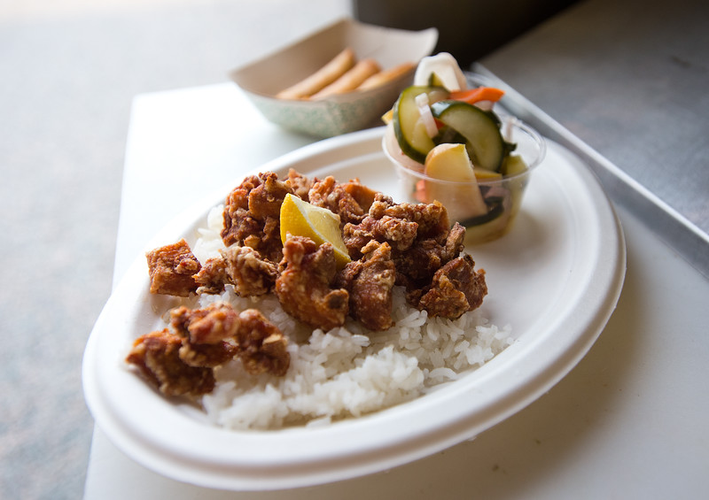 """Japanese fried chicken karaage with fresh ginger and garlic on Thai jasmine rice and a side of pineapple ginger sriracha sauce, is served by The Ginger Pig food truck at the new Rayback Collective food truck court in Boulder on Thursday. <br /> More photos:  <a href=""""http://www.dailycamera.com"""">http://www.dailycamera.com</a><br /> (Autumn Parry/Staff Photographer)<br /> July 28, 2016"""