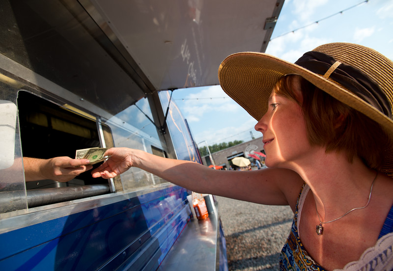 "BEST BEST BEST<br /> Dawn Jones pays for the meal she ordered from The Ginger Pig food truck at the new Rayback Collective food truck court in Boulder on Thursday. <br /> More photos:  <a href=""http://www.dailycamera.com"">http://www.dailycamera.com</a><br /> (Autumn Parry/Staff Photographer)<br /> July 28, 2016"