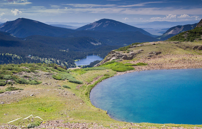 Lake Irwin sits about 1,000 feet below Green Lake and is actually much larger, despite looking smaller in this shot.  The valley off in the far right distance leads to Gunnison, south of Crested Butte.