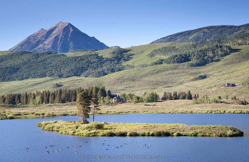Gothic Mountain towers over Peanut Lake near town.