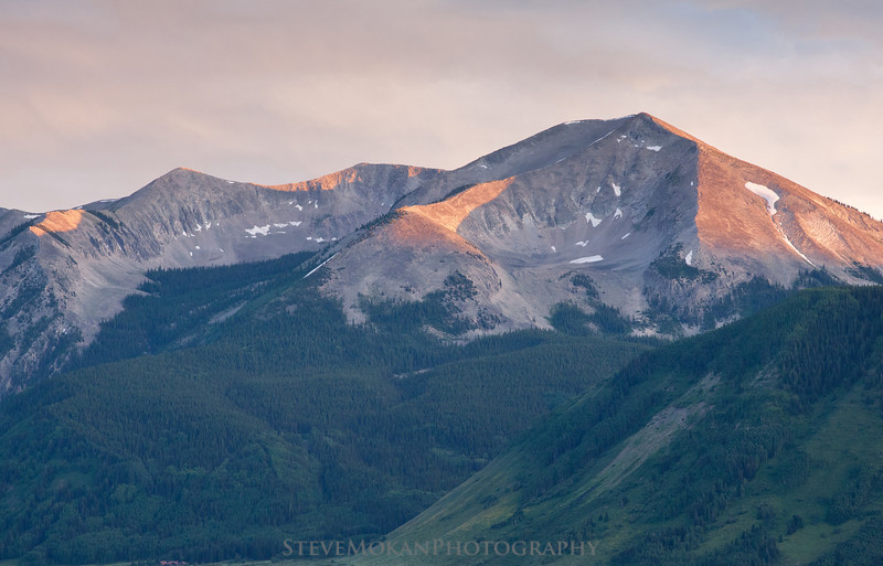 Whetstone Mountain towers above the town of Crested Butte at sunset.