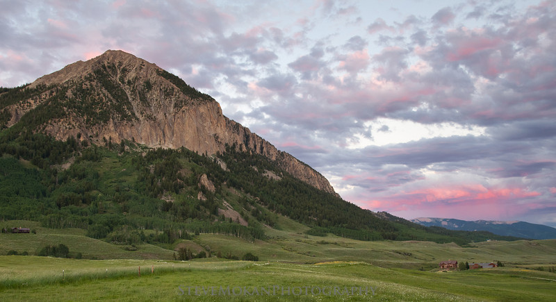 A beautiful sunset in the distance behind Mt. Crested Butte.