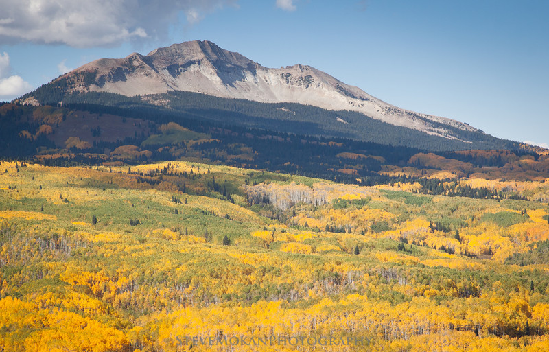West Beckwith Peak with a sea of gold and green at her feet.