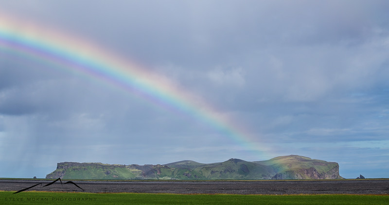After leaving Vik, we got a nice show when the rain mixed with a little sun and produced this rainbow over Hjorleifshofdi.