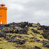 As we made our way west, we took a beat-up dirt road to the coast and found this orange light house overlooking some big rock cliffs.  It's amazing to see how this was built into the lava.