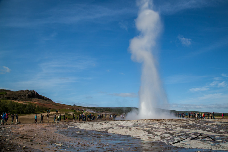 """The second stop in the Golden Circle (not counting Bruarfoss) is the geysir """"Strokkur"""".  As you can see, it's quite the tourist spot due to the tour buses that include it in their trips.  I wasn't sure what to think about this spot, but it's way cooler to see this in person.  It erupts every 5-10 minutes."""