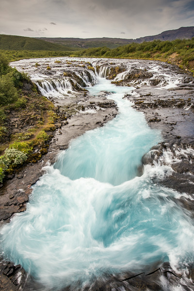 It was worth the effort.  Bruarfoss (means bridge waterfall, since there's a wooden bridge that spans over the river) is one of the most beautiful sights in Iceland.  The glacial blue water is even brighter in person.