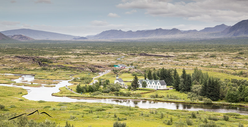 The main valley of Thingvellir, with the original parliament buildings and church below along the river.