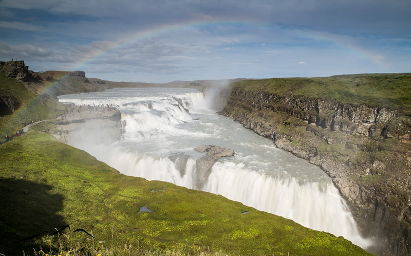 "The last stop on the Golden Circle is Gullfoss, an absolutely enormous waterfall ""system"" that drops over 200 feet.  We got lucky with the weather, when it's sunny outside the spray creates a constant rainbow over the falls."