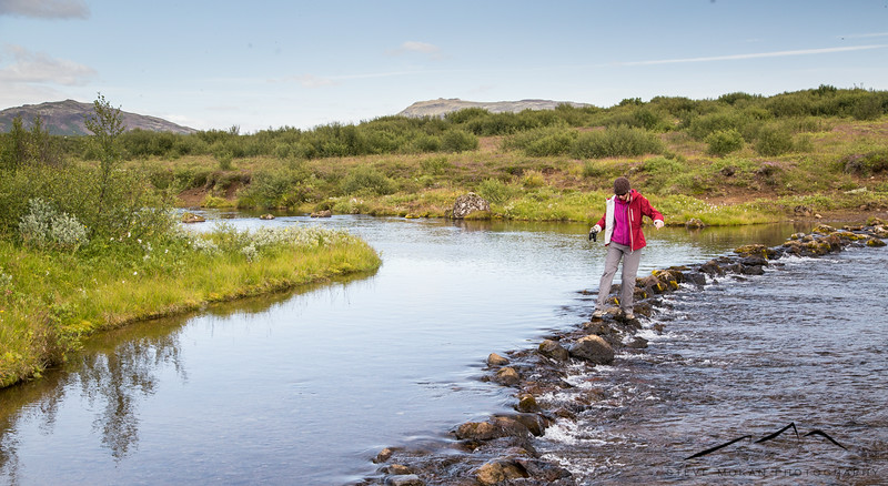 """After Thingvellir, we took a detour and decided to look for the Bruarfoss waterfall, a famously elusive location to find.  We can see why- after walking through marsh and brush, we decided to cross this """"rock bridge"""" to keep looking."""