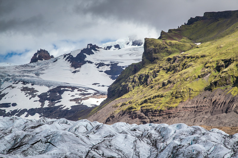 The sun peaked through occasionally, showing us the icefall and the green peaks above.