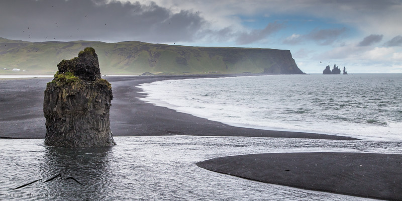 In-between rain drops, I got this picture looking north towards the Reynisdrangar sea stacks and the mountain we just climbed.  You can see more of the black sand beach in this shot.