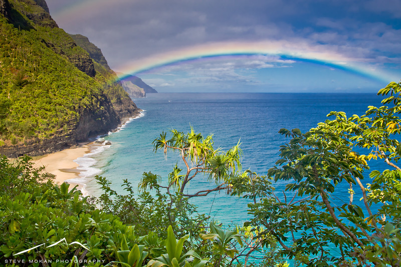 Another favorite.... the sun came out for a split second while a rainbow was literally right in front of us.  That's Hanakapaia Beach down below, and the Napali coast in the distance.