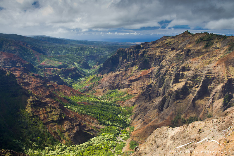 Looking south from a lookout in Waimea Canyon- if you look way off in the distance (about 10 miles) you can see the ocean.