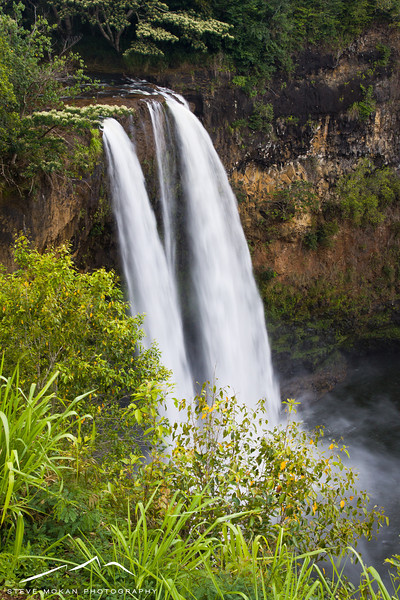 Wailua Falls, a 150+ foot dual waterfall that's quite the tourist spot on Kauai.  It's very close to the airport, so it's an easy sight to see with little effort.