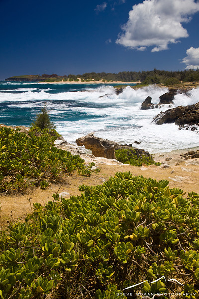 Looking back towards some crashing waves and another beach in the background, also one of the Maha'ulepa Beaches.