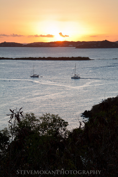 Two sailboats heading into the sunset over St. Thomas.