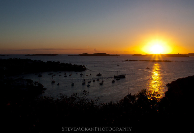 A great sunset over St. Thomas to the west, with Cruz Bay sitting in the foreground.