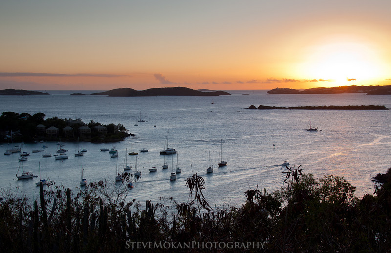 Another great shot of the sun setting over St. Thomas to the west, with Cruz Bay in the foreground.  Gallows Point Resort is on the small point to the left.