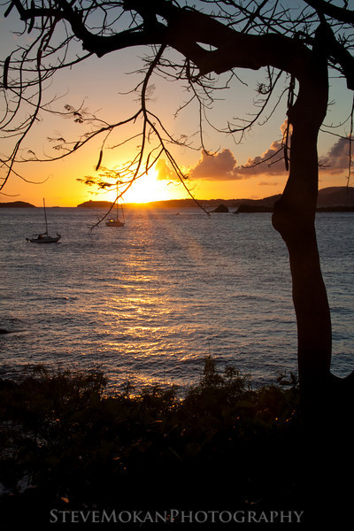 Looking at the sun set to the west over St. Thomas from the beach at Gallows Point.