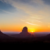 "The next morning, Sarah and I witnessed one of the most amazing sunrises we've ever seen.  Monument Valley is a truly special place in northern Arizona.  The monuments sit on Navajo Indian land in the middle of nowhere, but they are absolutely worth the trip to see this magical place.  This picture is of the two ""Mittens"" and Merrick Butte."
