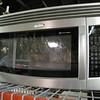 like new (floor model) stainless steel microwave: $350