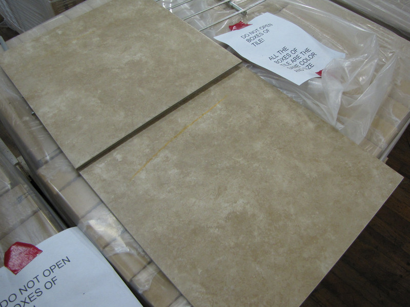 """new 18""""x18"""" tile: $18 per box (18 sq ft per box = $1 per sq ft)<br /> several skids available, all same color"""