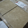 "new 18""x18"" tile: $18 per box (18 sq ft per box = $1 per sq ft)<br /> several skids available, all same color"