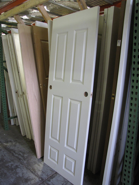 Don't mind if your door has two knob holes? Only $1 !<br /> Great as a confusing door, table top, head board, room divider, picture frame, chalk board, sled (?)