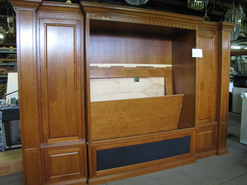 solid wood entertainment center: $2,000