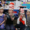 HOLLY PELCZYNSKI - BENNINGTON BANNER Selena Write, looks and listens while Meara Camp,  reads to her peers while Mason Yeardon & Matthew Perkins peak over her shoulder during the read across America event held at Molly Stark School on Bennington on Monday morning. The Read Across America event is held yearly to celebrate the  birthday Dr. Seuss.