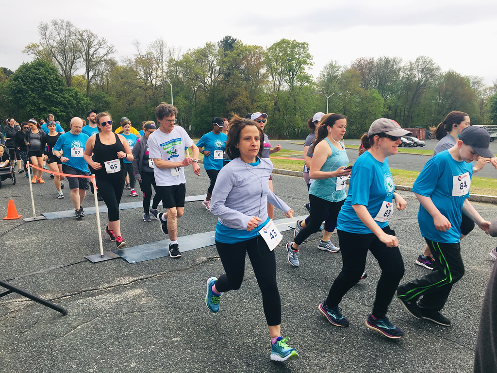 . Runners crossed the start line for the third annual Reader Run 5K to benefit the Billerica Library. Photo by Mary Leach